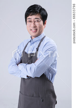 A studio portrait of Asian man making a confident smile 252 66633798