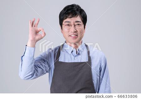 A studio portrait of Asian man making a confident smile 283 66633806