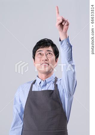 A studio portrait of Asian man making a confident smile 281 66633814