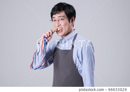 A studio portrait of Asian man making a confident smile 316 66633829