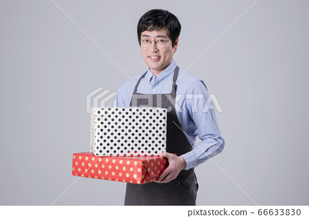 A studio portrait of Asian man making a confident smile 348 66633830