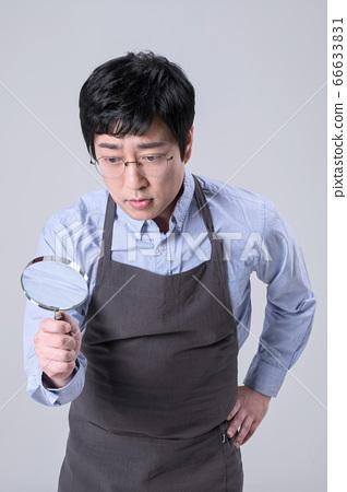 A studio portrait of Asian man making a confident smile 365 66633831