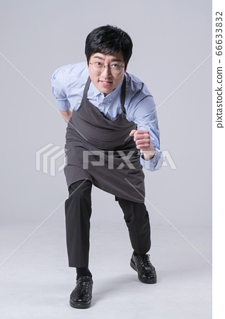 A studio portrait of Asian man making a confident smile 323 66633832