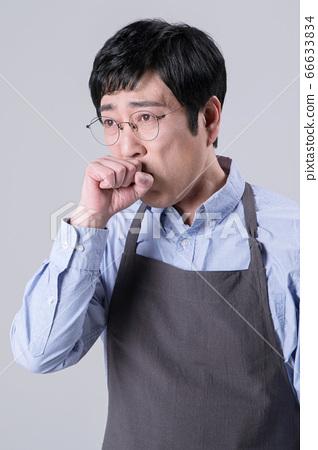 A studio portrait of Asian man making a confident smile 260 66633834