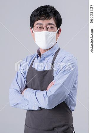 A studio portrait of Asian man making a confident smile 351 66633837