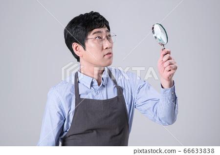 A studio portrait of Asian man making a confident smile 345 66633838