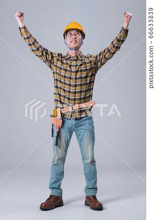 A studio portrait of Asian man making a confident smile 407 66633839