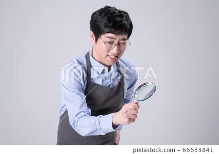 A studio portrait of Asian man making a confident smile 347 66633841