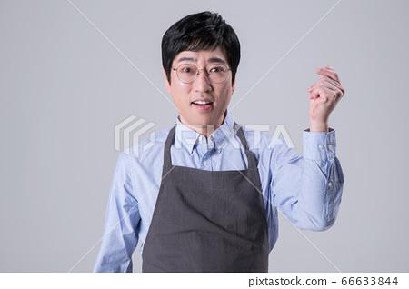 A studio portrait of Asian man making a confident smile 328 66633844