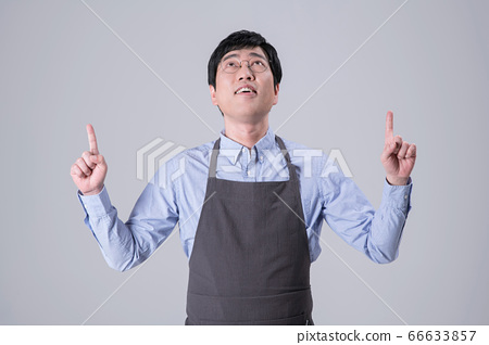 A studio portrait of Asian man making a confident smile 258 66633857