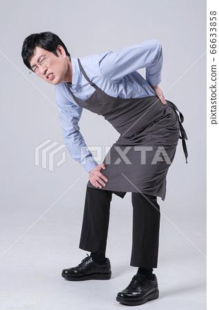 A studio portrait of Asian man making a confident smile 309 66633858