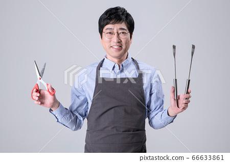 A studio portrait of Asian man making a confident smile 277 66633861