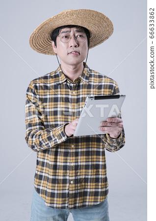 A studio portrait of Asian man making a confident smile 193 66633862
