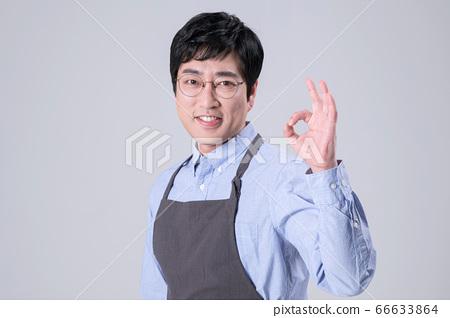 A studio portrait of Asian man making a confident smile 257 66633864