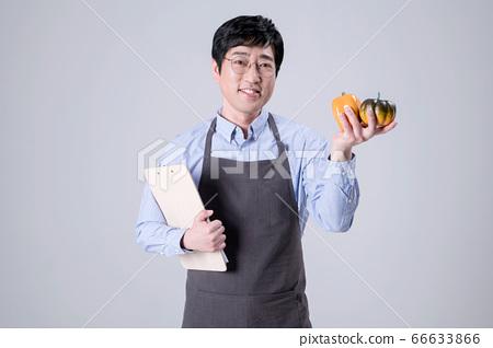 A studio portrait of Asian man making a confident smile 297 66633866