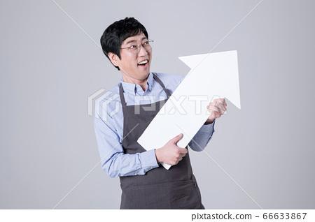 A studio portrait of Asian man making a confident smile 289 66633867