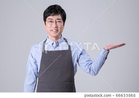 A studio portrait of Asian man making a confident smile 292 66633868
