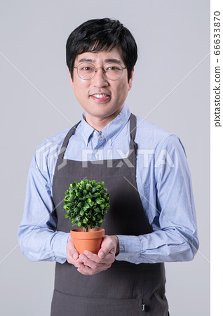 A studio portrait of Asian man making a confident smile 272 66633870