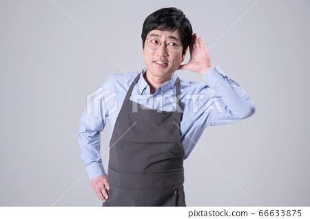 A studio portrait of Asian man making a confident smile 271 66633875