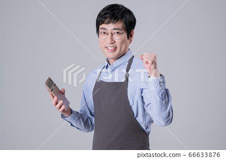 A studio portrait of Asian man making a confident smile 334 66633876