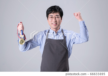 A studio portrait of Asian man making a confident smile 311 66633895