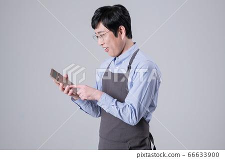 A studio portrait of Asian man making a confident smile 255 66633900