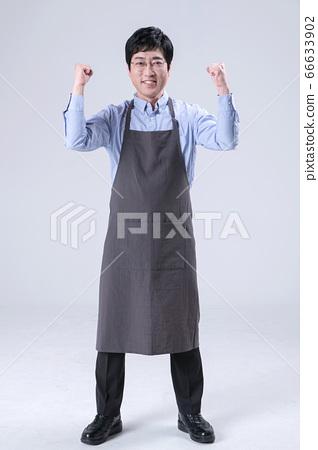 A studio portrait of Asian man making a confident smile 259 66633902