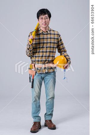 A studio portrait of Asian man making a confident smile 377 66633904