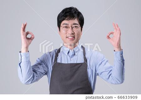 A studio portrait of Asian man making a confident smile 286 66633909