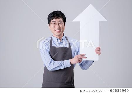 A studio portrait of Asian man making a confident smile 267 66633940