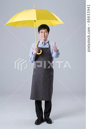 A studio portrait of Asian man making a confident smile 121 66633941