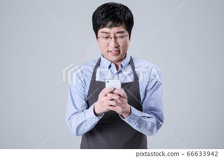 A studio portrait of Asian man making a confident smile 122 66633942