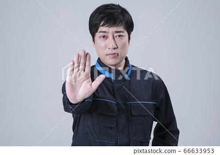 A studio portrait of Asian man making a confident smile 138 66633953