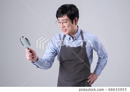 A studio portrait of Asian man making a confident smile 364 66633955
