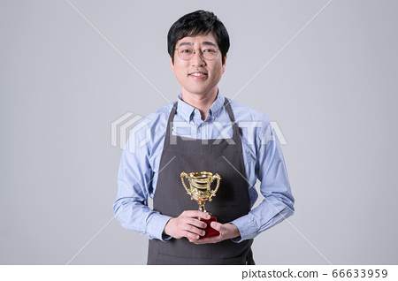 A studio portrait of Asian man making a confident smile 358 66633959