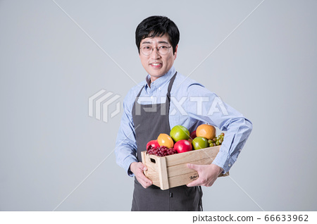 A studio portrait of Asian man making a confident smile 114 66633962