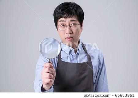 A studio portrait of Asian man making a confident smile 340 66633963