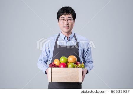 A studio portrait of Asian man making a confident smile 111 66633987