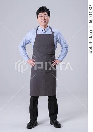 A studio portrait of Asian man making a confident smile 305 66634002