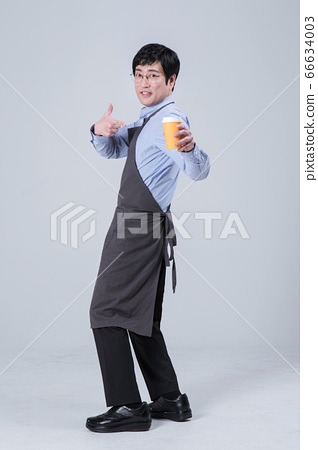 A studio portrait of Asian man making a confident smile 115 66634003