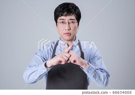 A studio portrait of Asian man making a confident smile 117 66634008