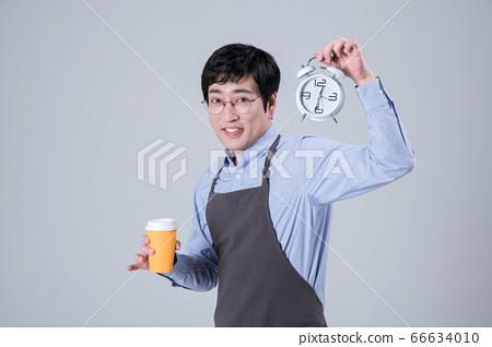 A studio portrait of Asian man making a confident smile 102 66634010