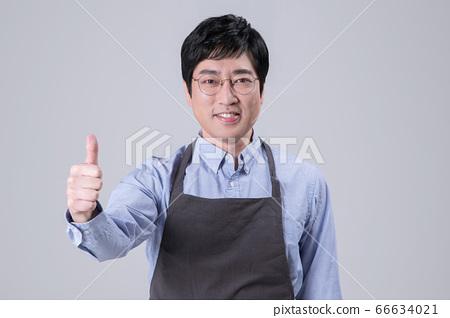 A studio portrait of Asian man making a confident smile 287 66634021