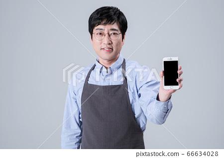A studio portrait of Asian man making a confident smile 078 66634028