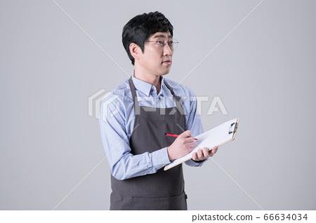 A studio portrait of Asian man making a confident smile 263 66634034