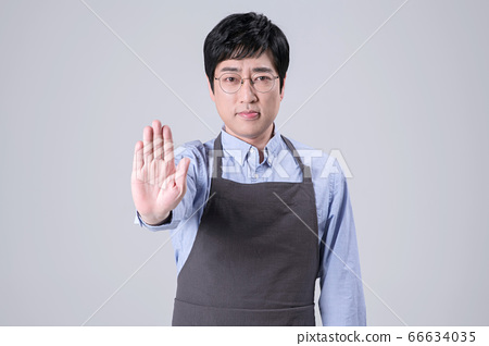 A studio portrait of Asian man making a confident smile 249 66634035