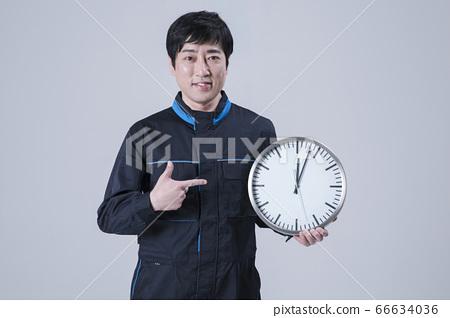 A studio portrait of Asian man making a confident smile 155 66634036