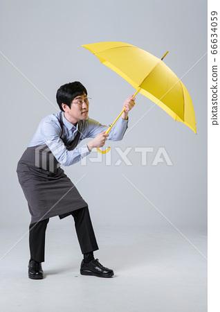 A studio portrait of Asian man making a confident smile 087 66634059