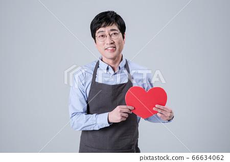 A studio portrait of Asian man making a confident smile 077 66634062