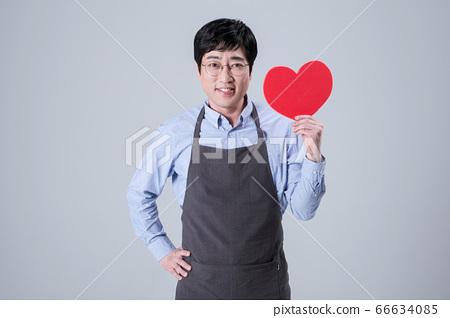 A studio portrait of Asian man making a confident smile 047 66634085